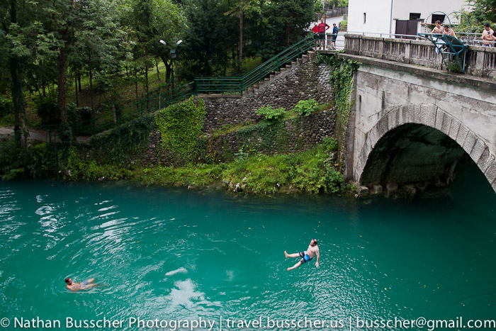 Jumping from a bridge into emerald green water.  This guy had a very bad entry into the water... but first... ouch.  I don't think he will be sitting down again for a while.